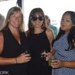Guests and Laura Perotti at Sunset on the Harbor