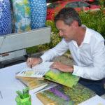 Frederico Azevedo signing books